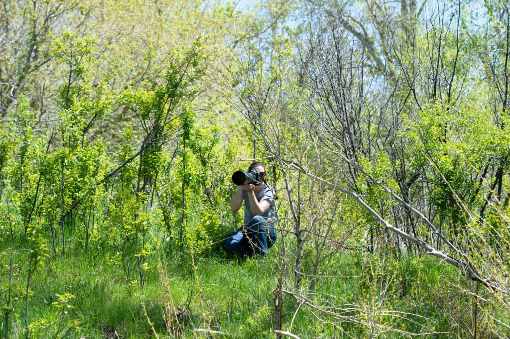 Weaver Leather Micheala taking pictures in the brush